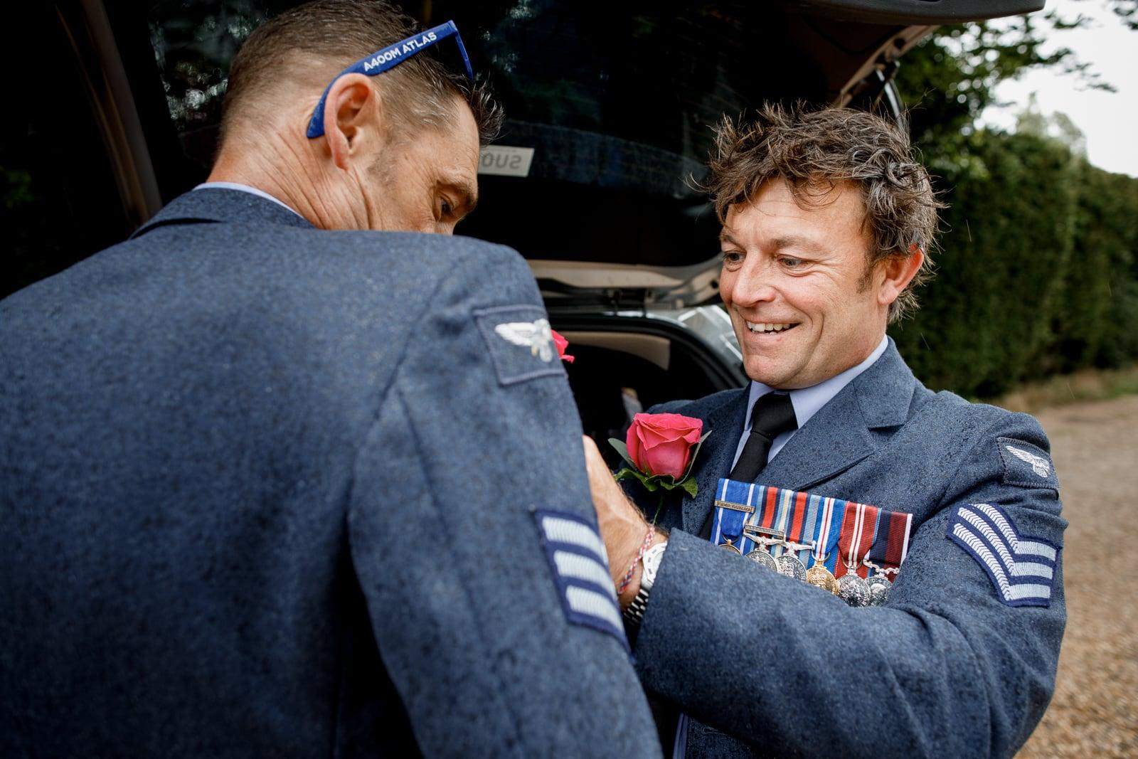 military wedding grooms going through prep