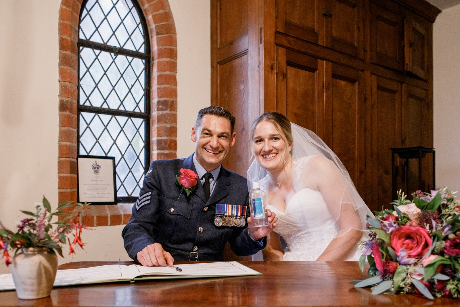 bride and groom with hand sanitiser