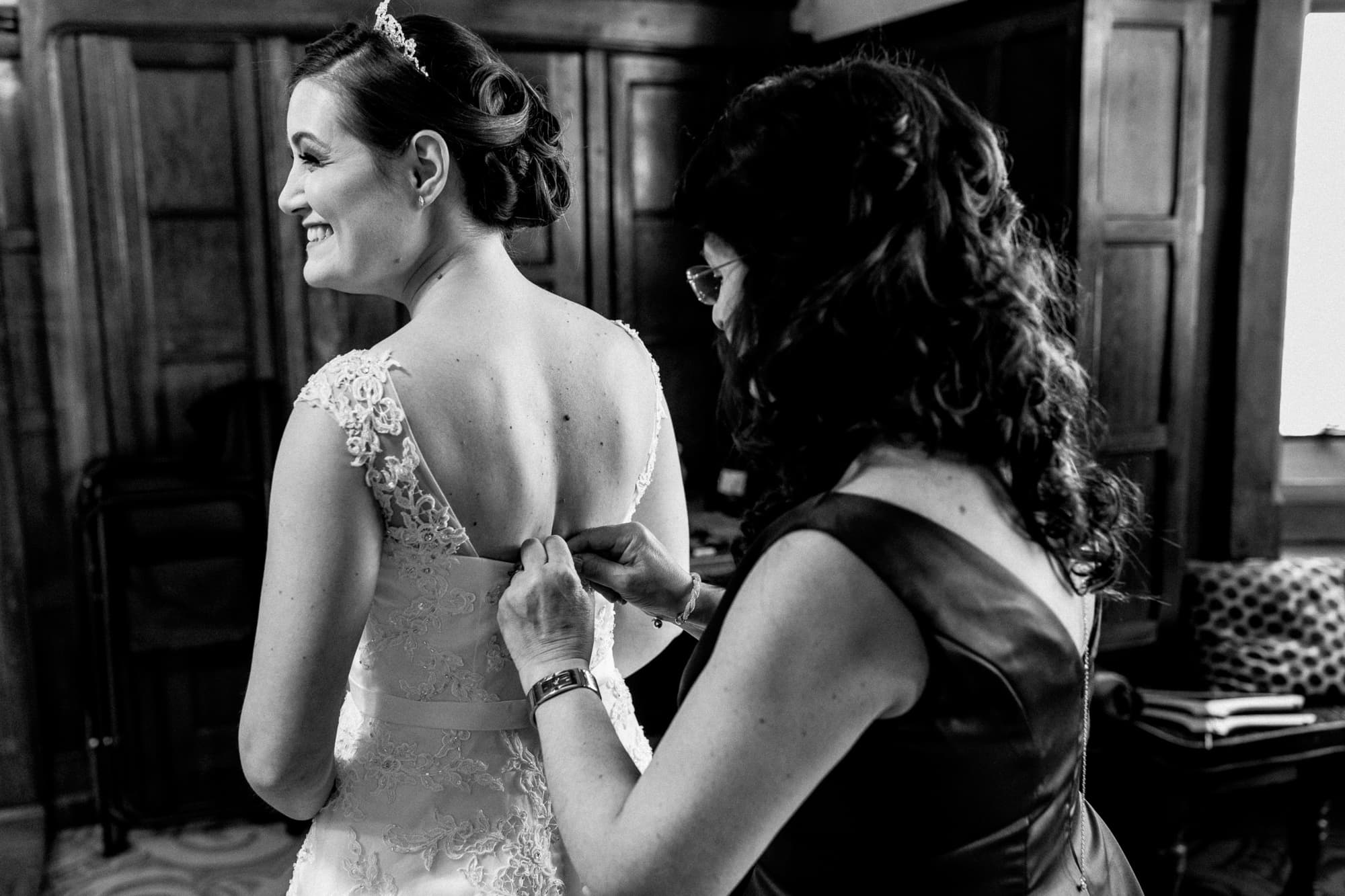 mother doing brides dress up