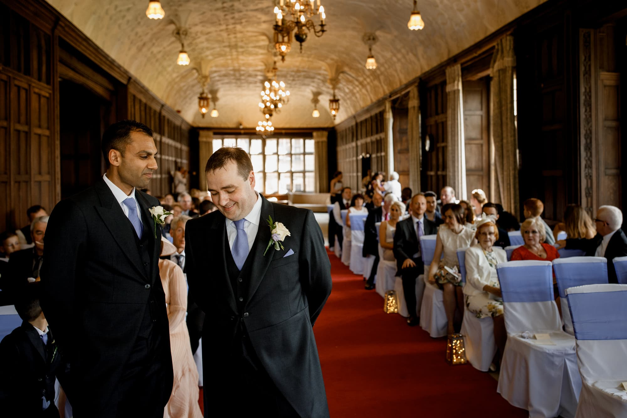 groom waiting for bride at front of ceremony