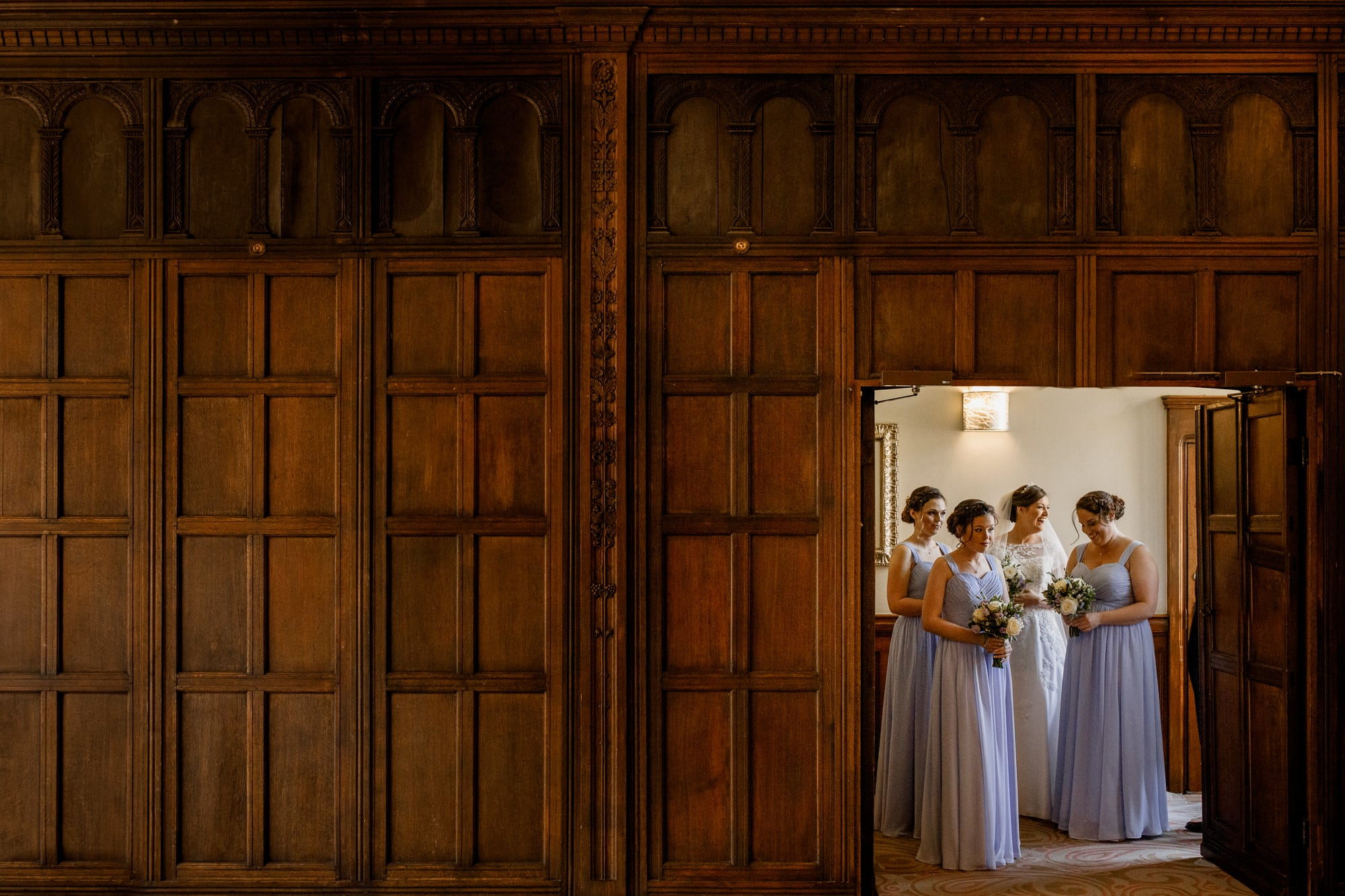 bride waiting with bridesmaids at the long gallery room