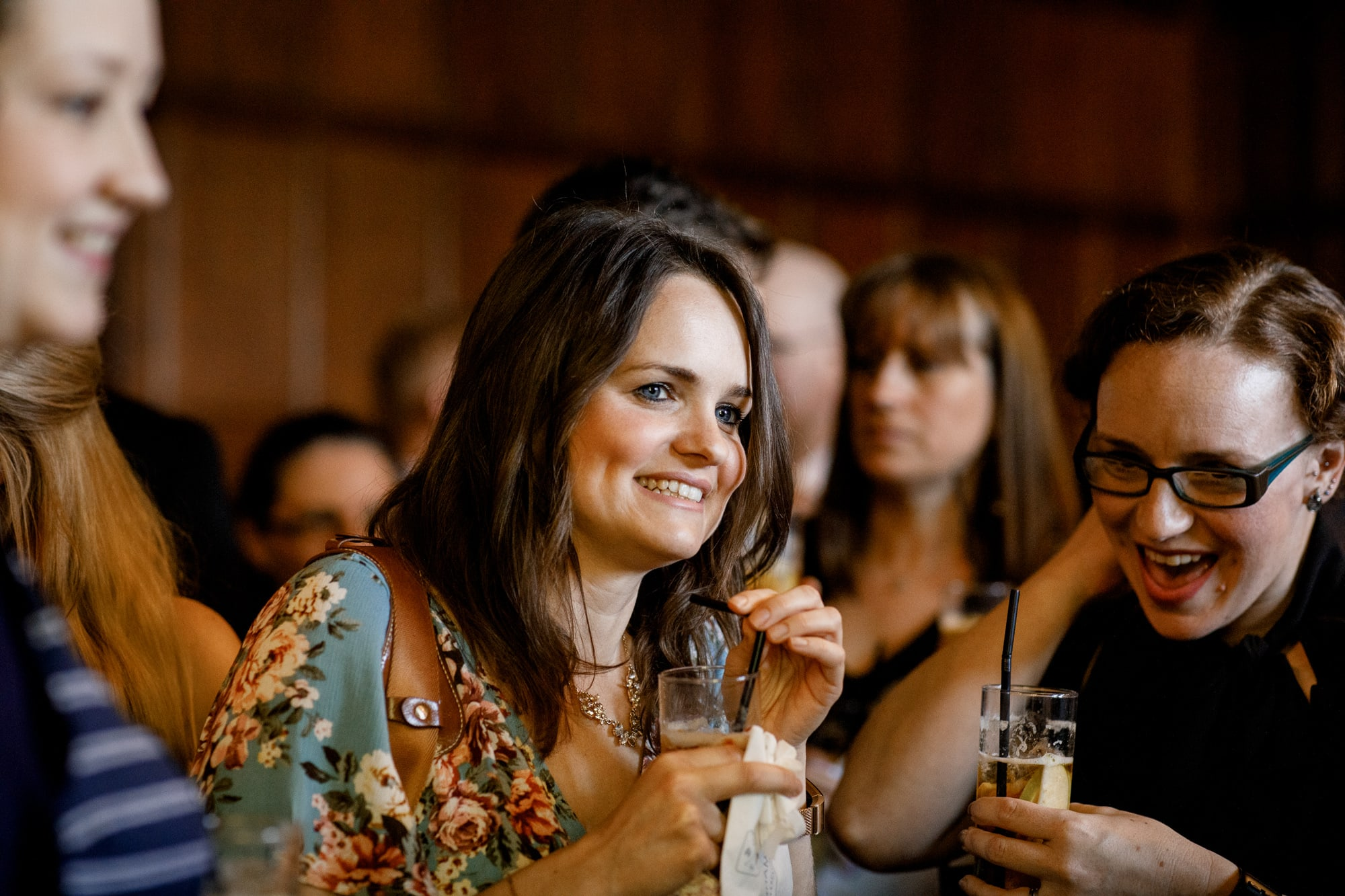 guests enjoying drink at wedding