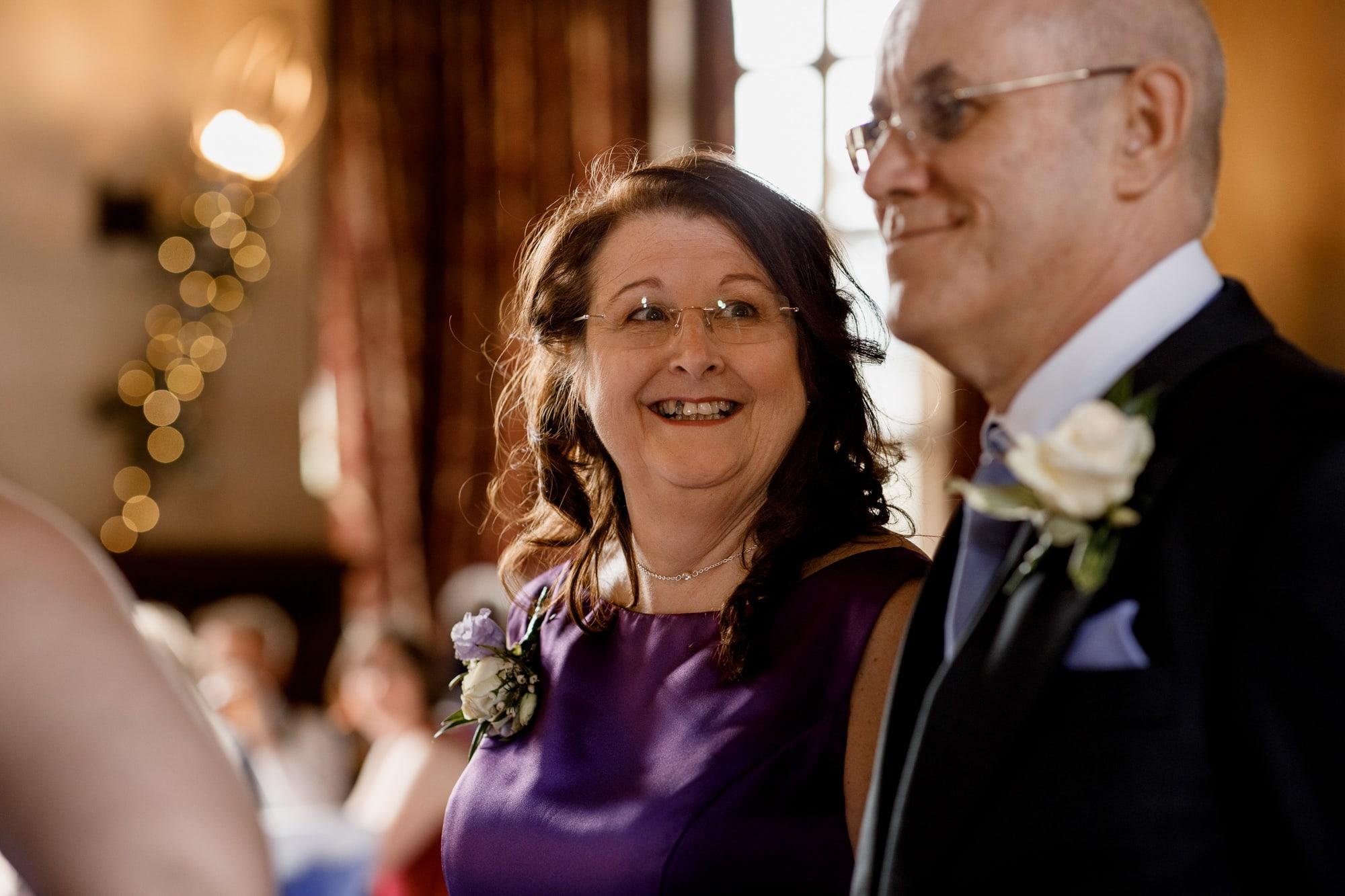 parents smiling at wedding
