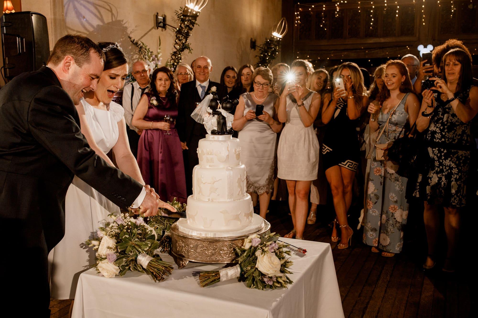 cutting the cake at fanhams hall wedding