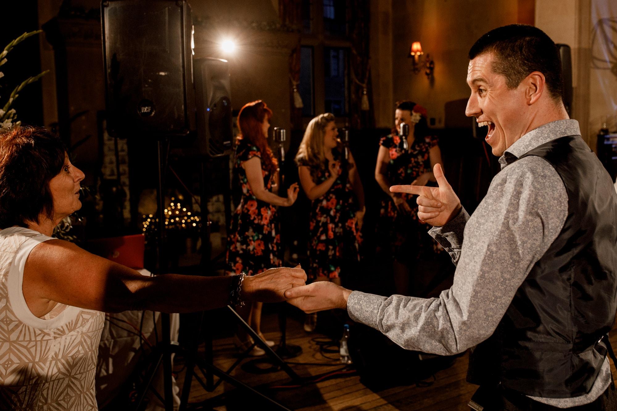 guests on dance floor at wedding