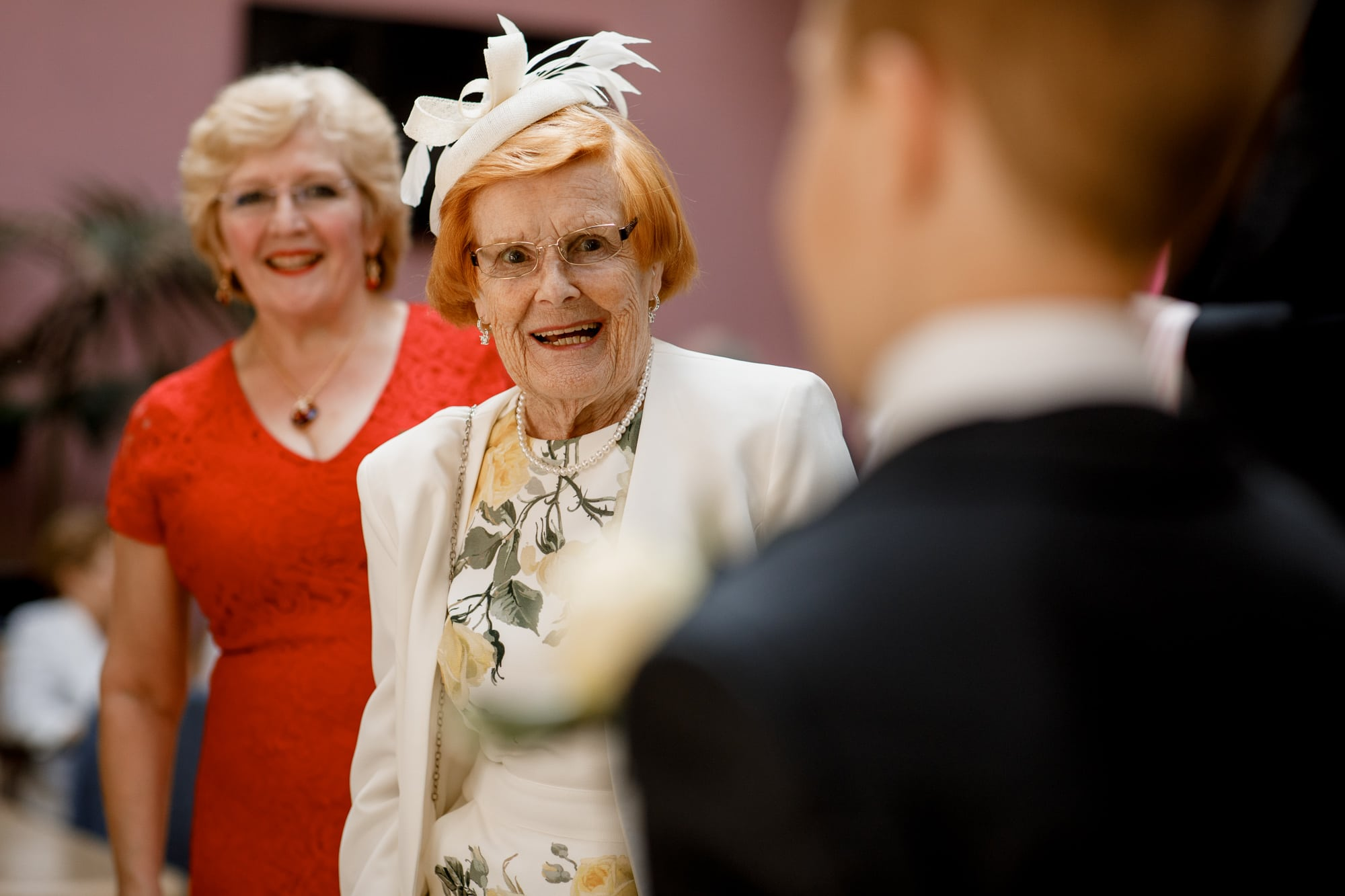 grandma smiling at page boy