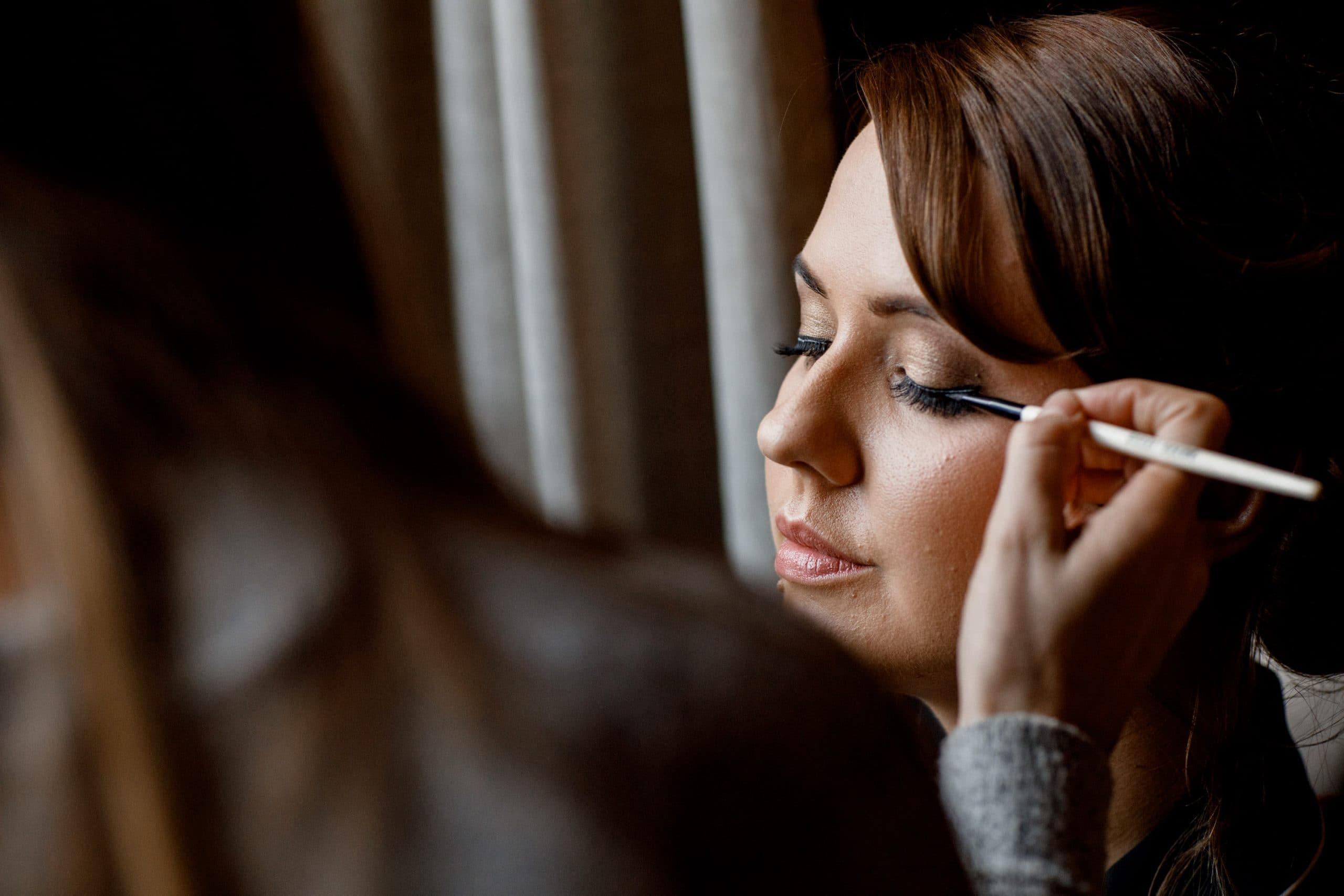 makeup being applied at great fosters wedding