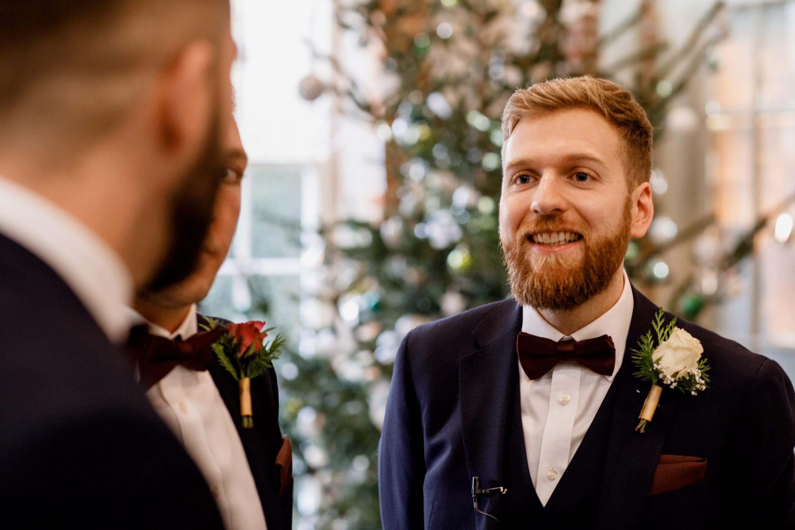 groom at winter wedding