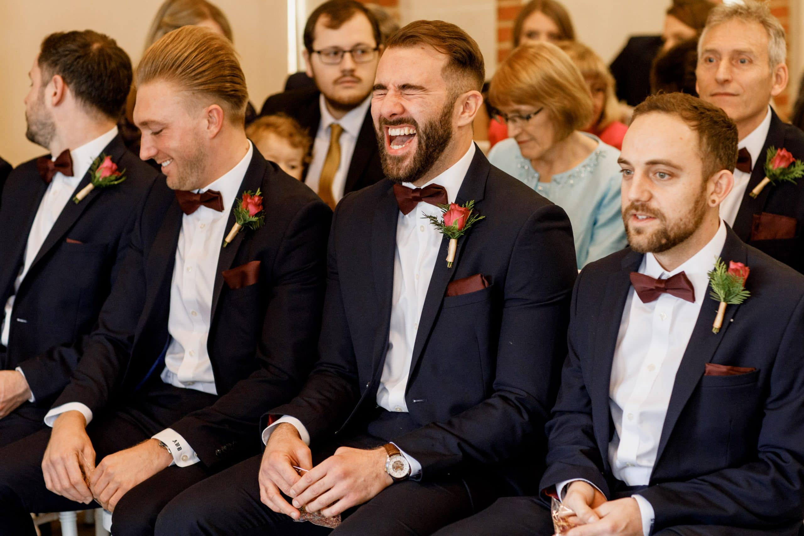 best man laughing at ceremony