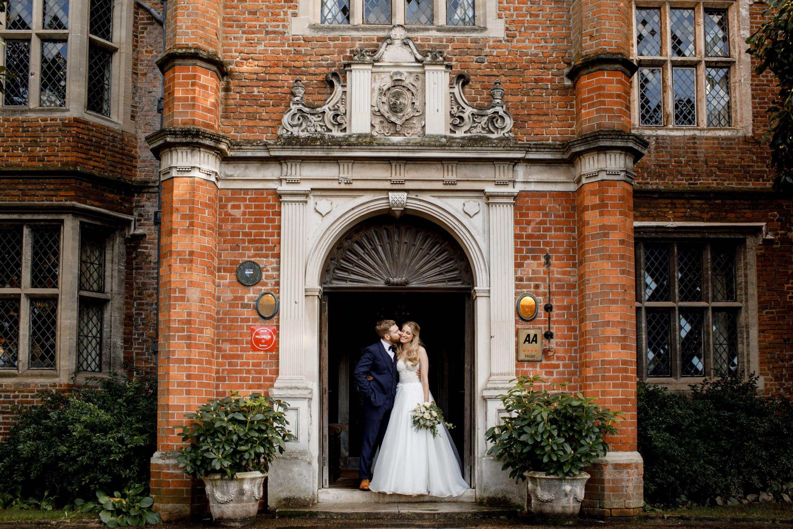bride and groom outside great fosters