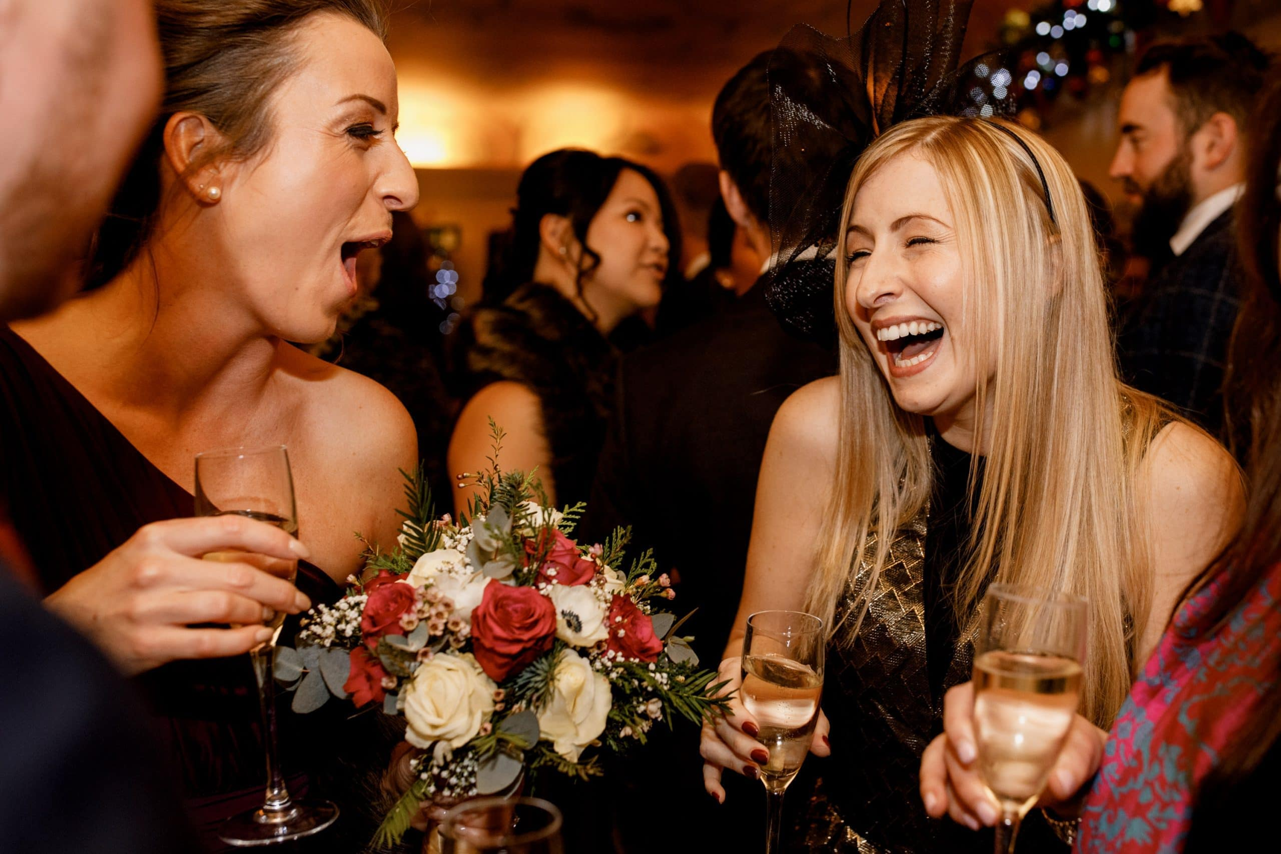 guests laughing at great fosters wedding