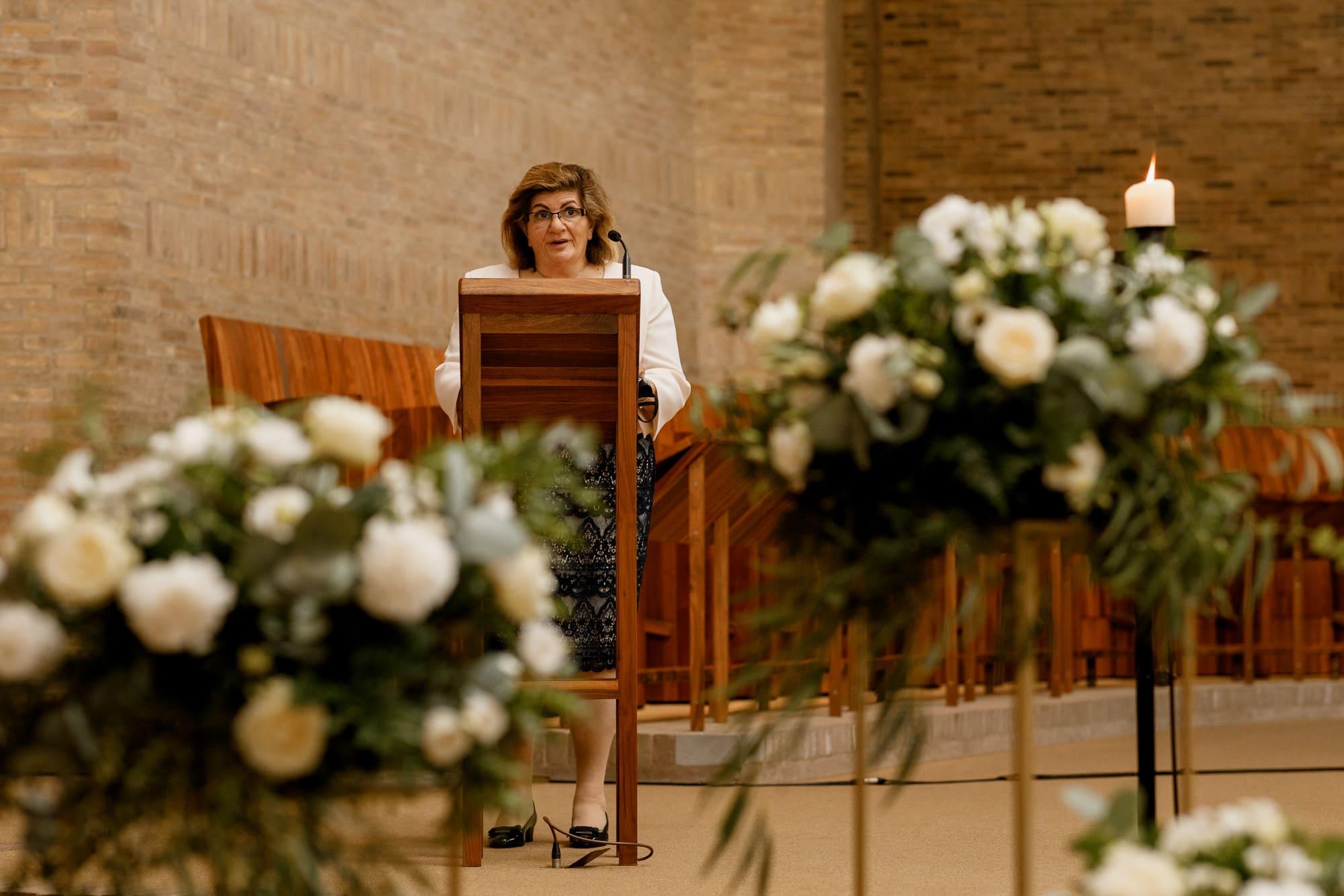 wedding speech behind flowers