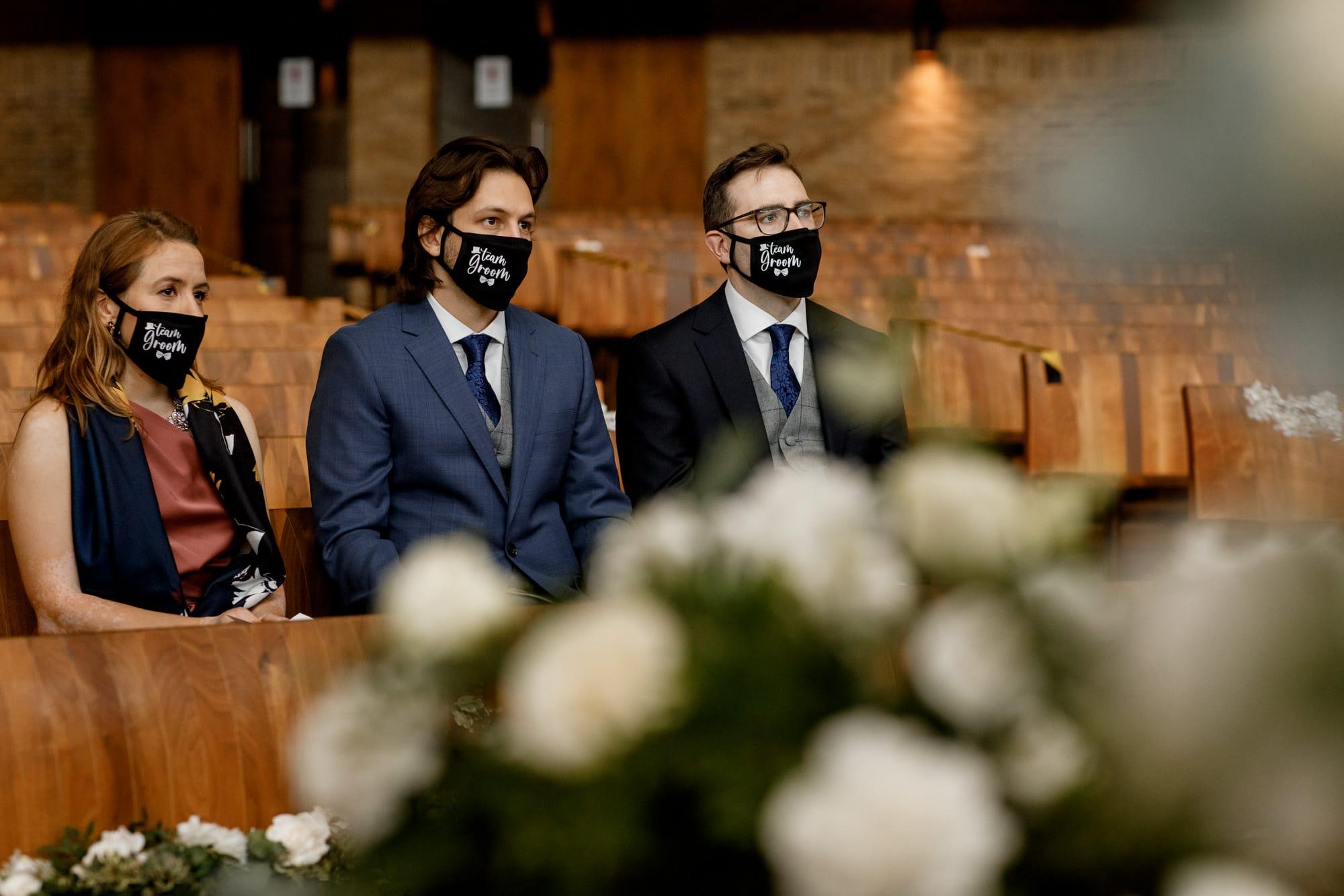 guests wearing masks at covid-19 wedding