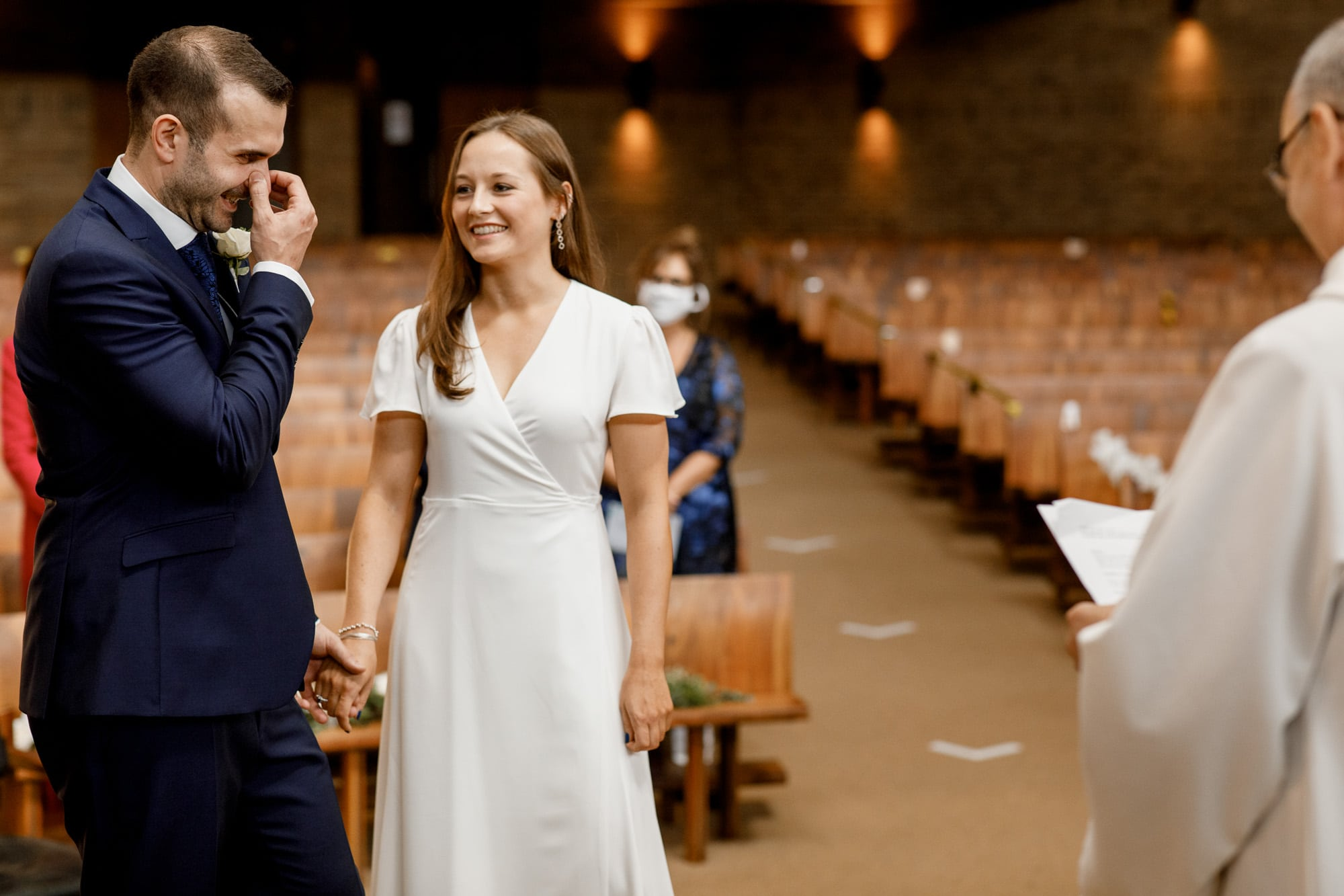bride and groom laughing at covid secure wedding