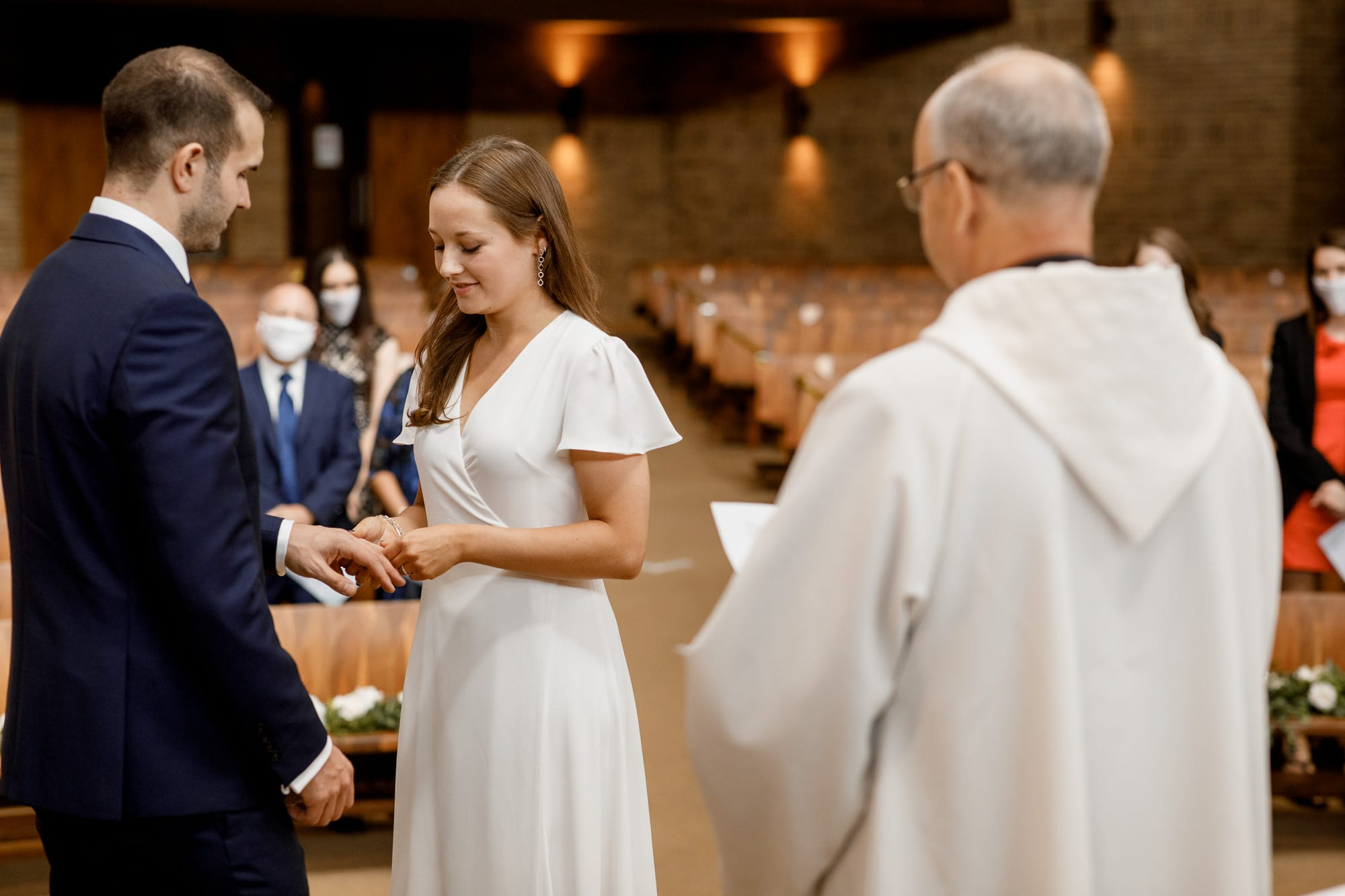 exchanging of the rings at covid-19 wedding ceremony