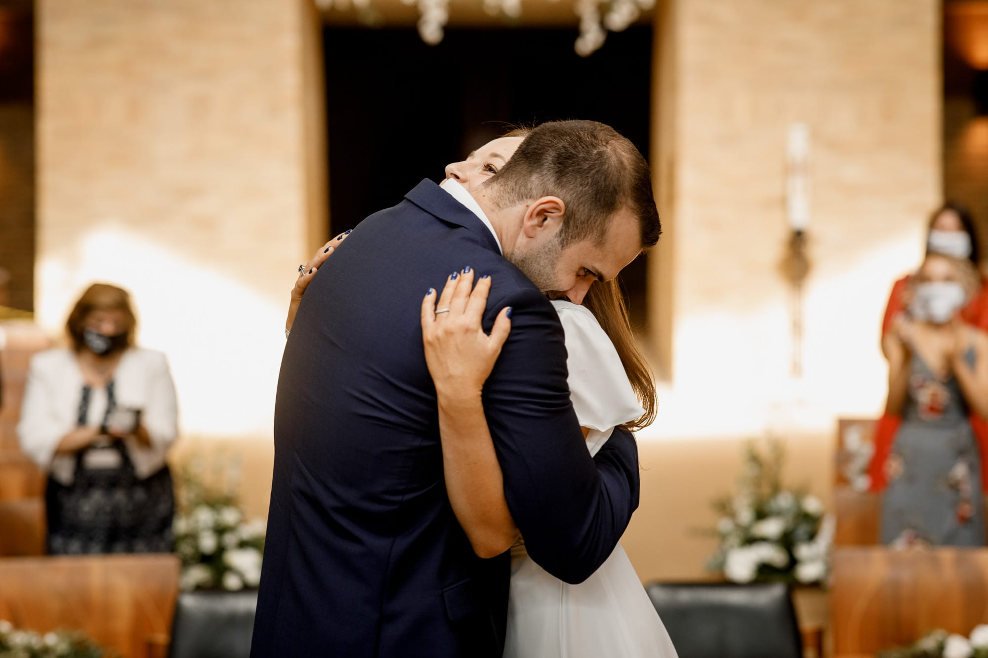 couple embracing at covid wedding