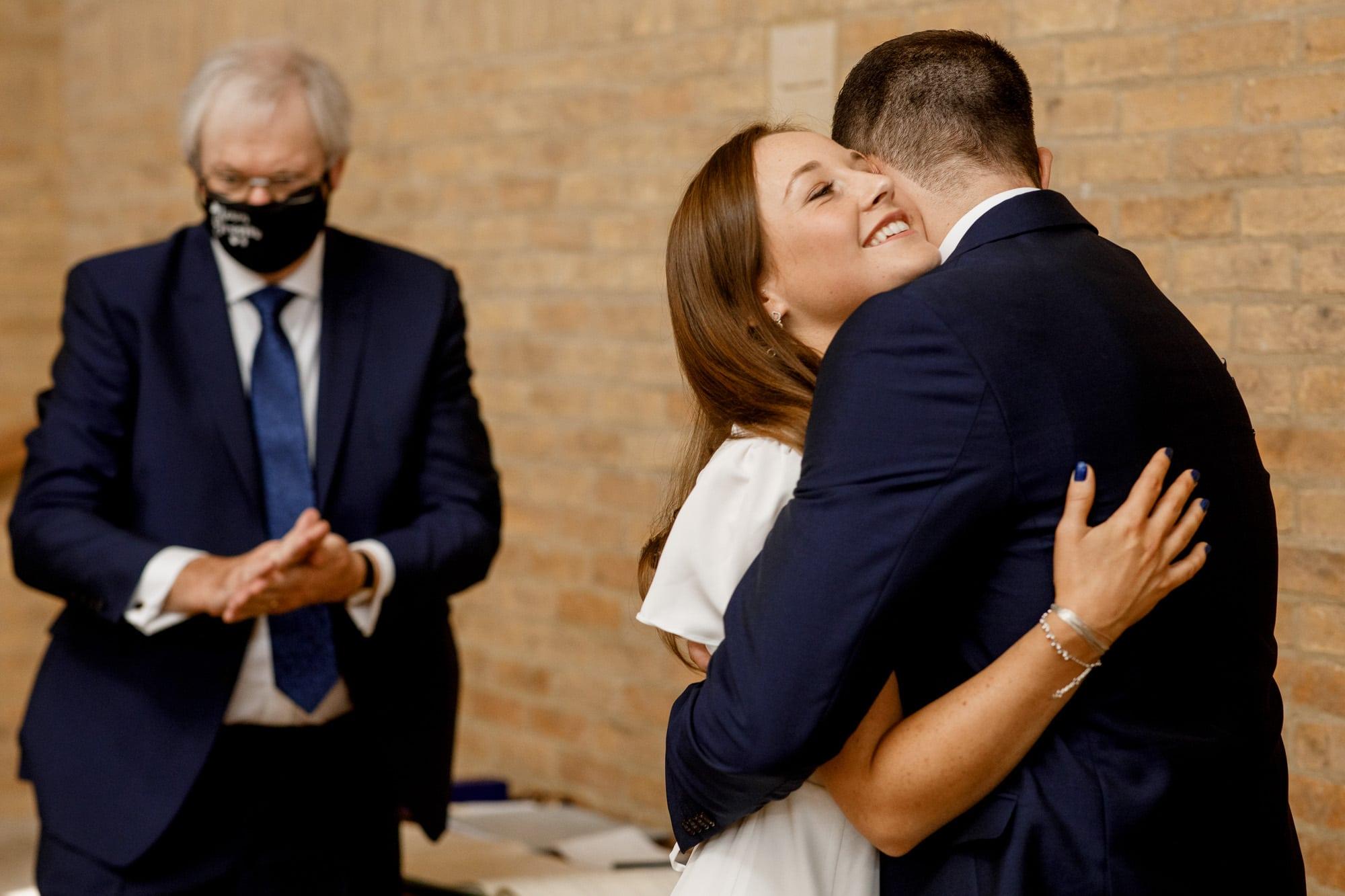 bride and groom hugging at covid wedding