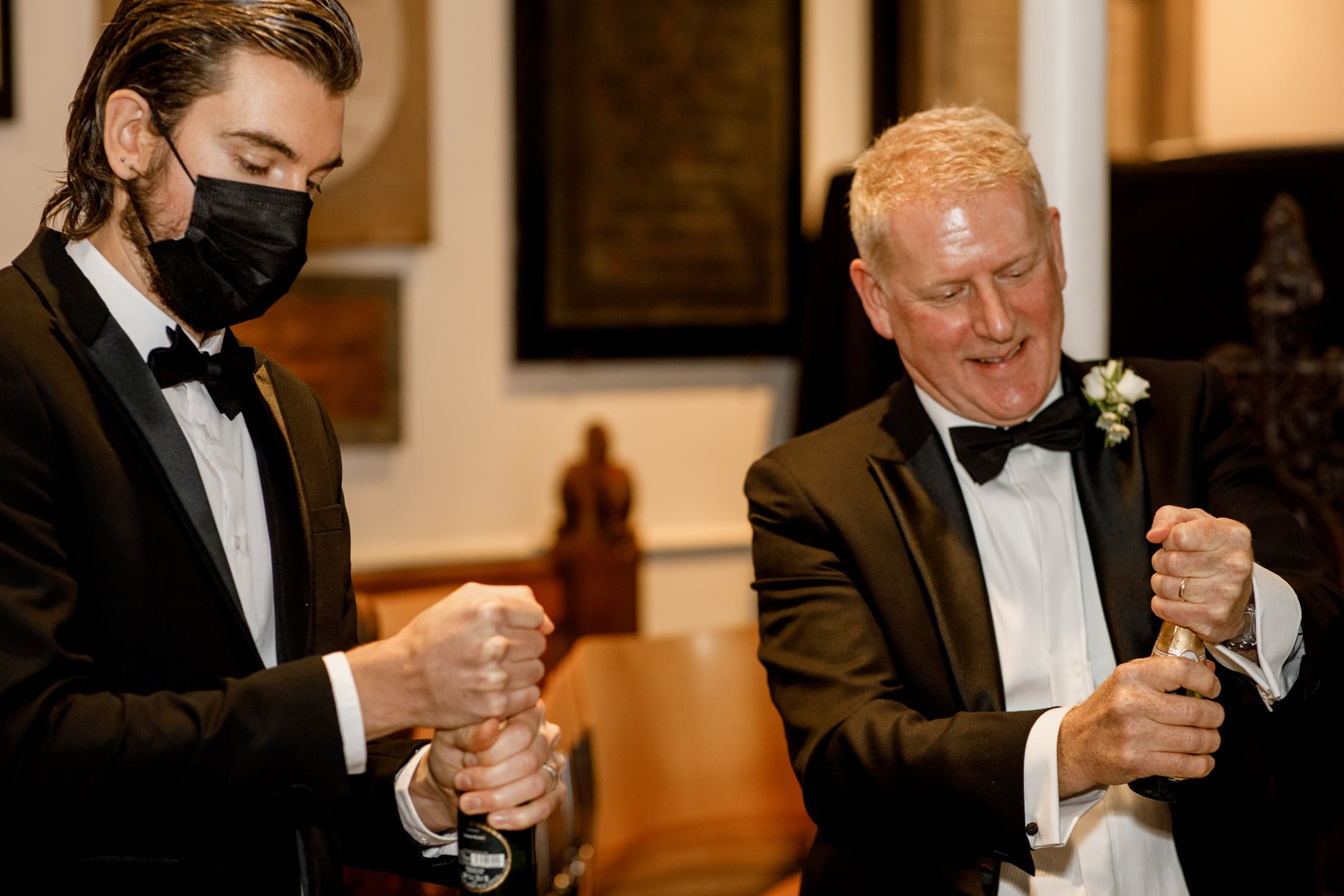 groom and best man opening champagne