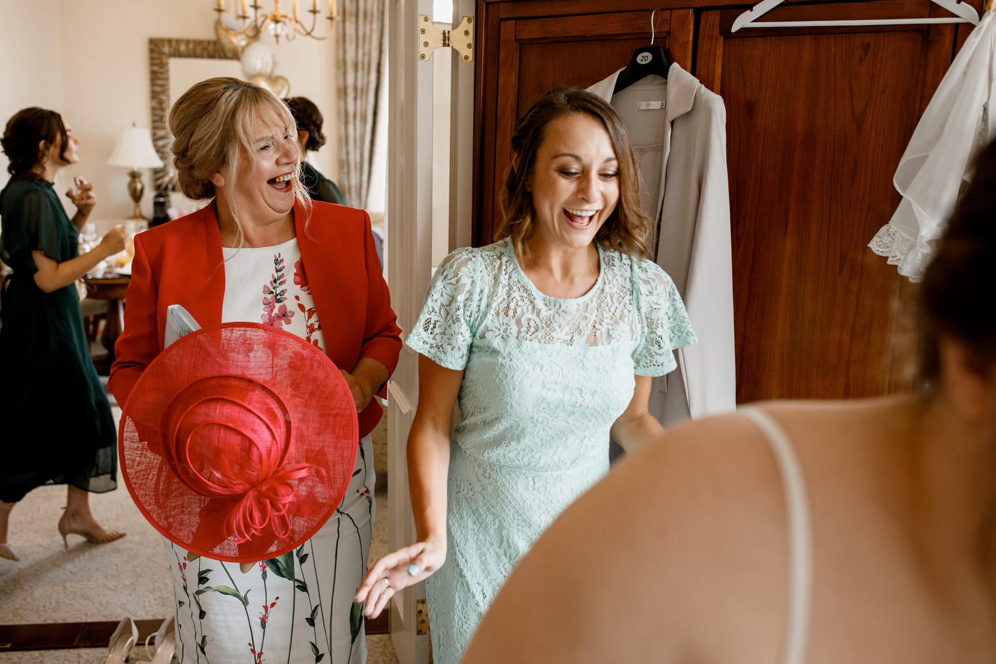 laughing during bridal preparation