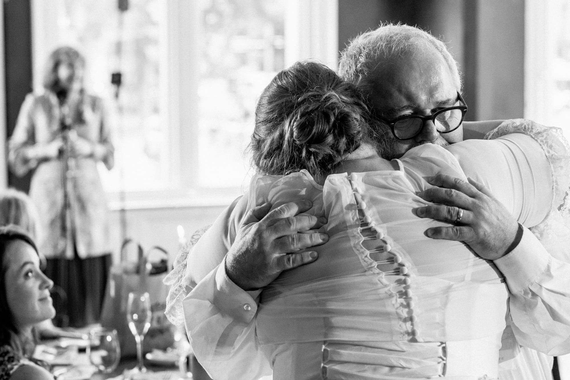 father and bride hugging at the randolph hotel wedding