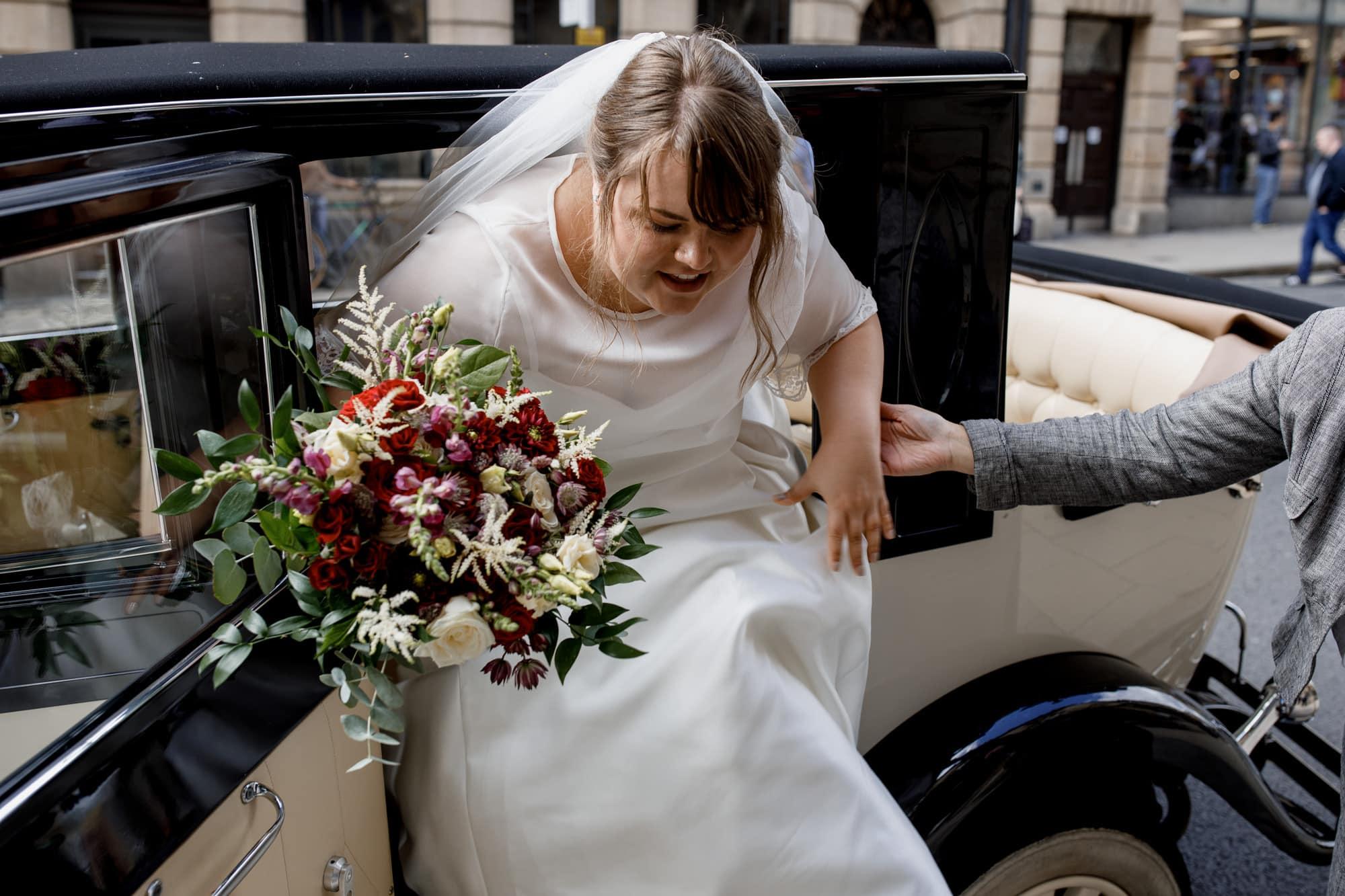 bride arriving in antique car