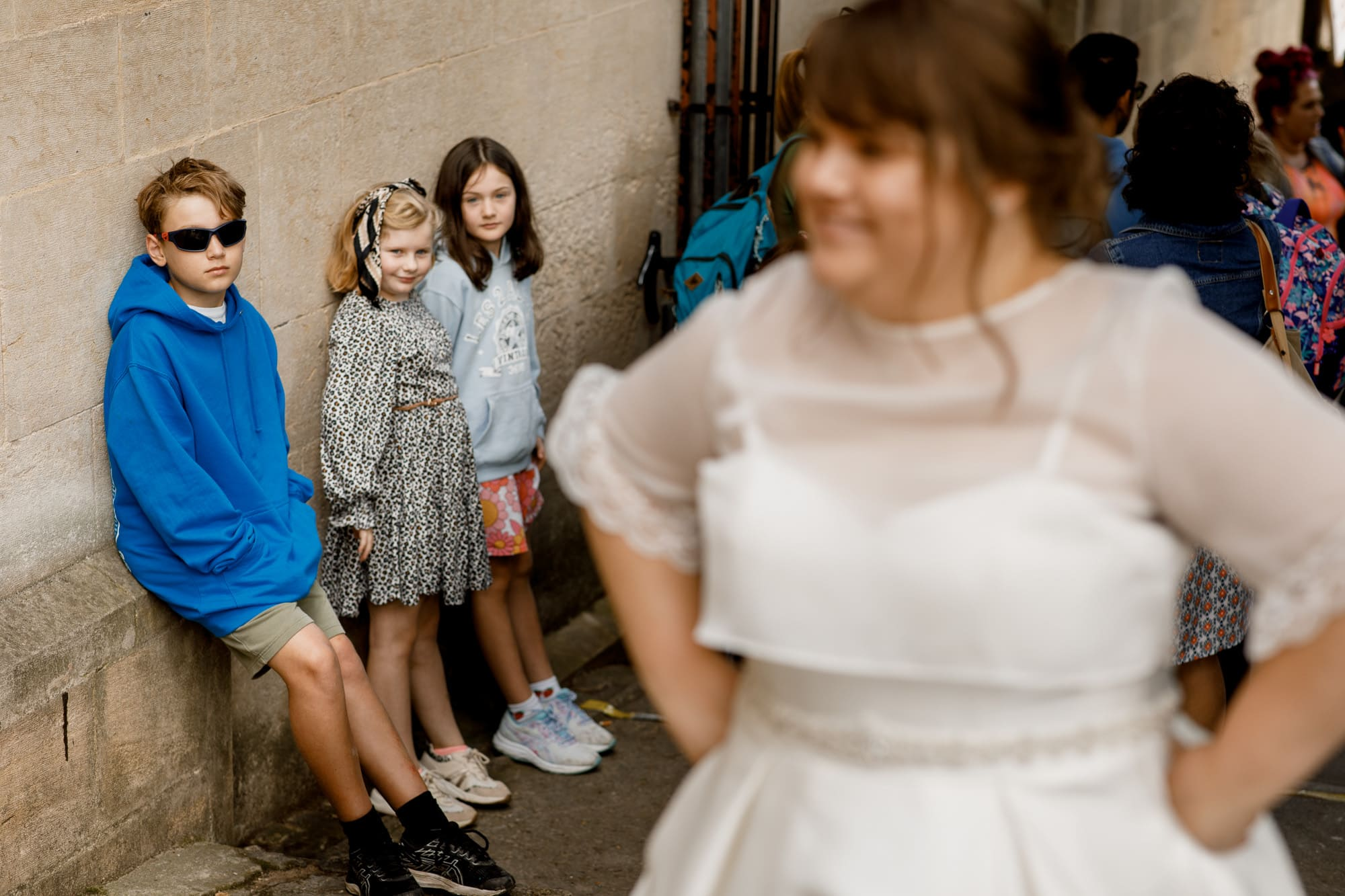 boy looking at bride with sunglasses