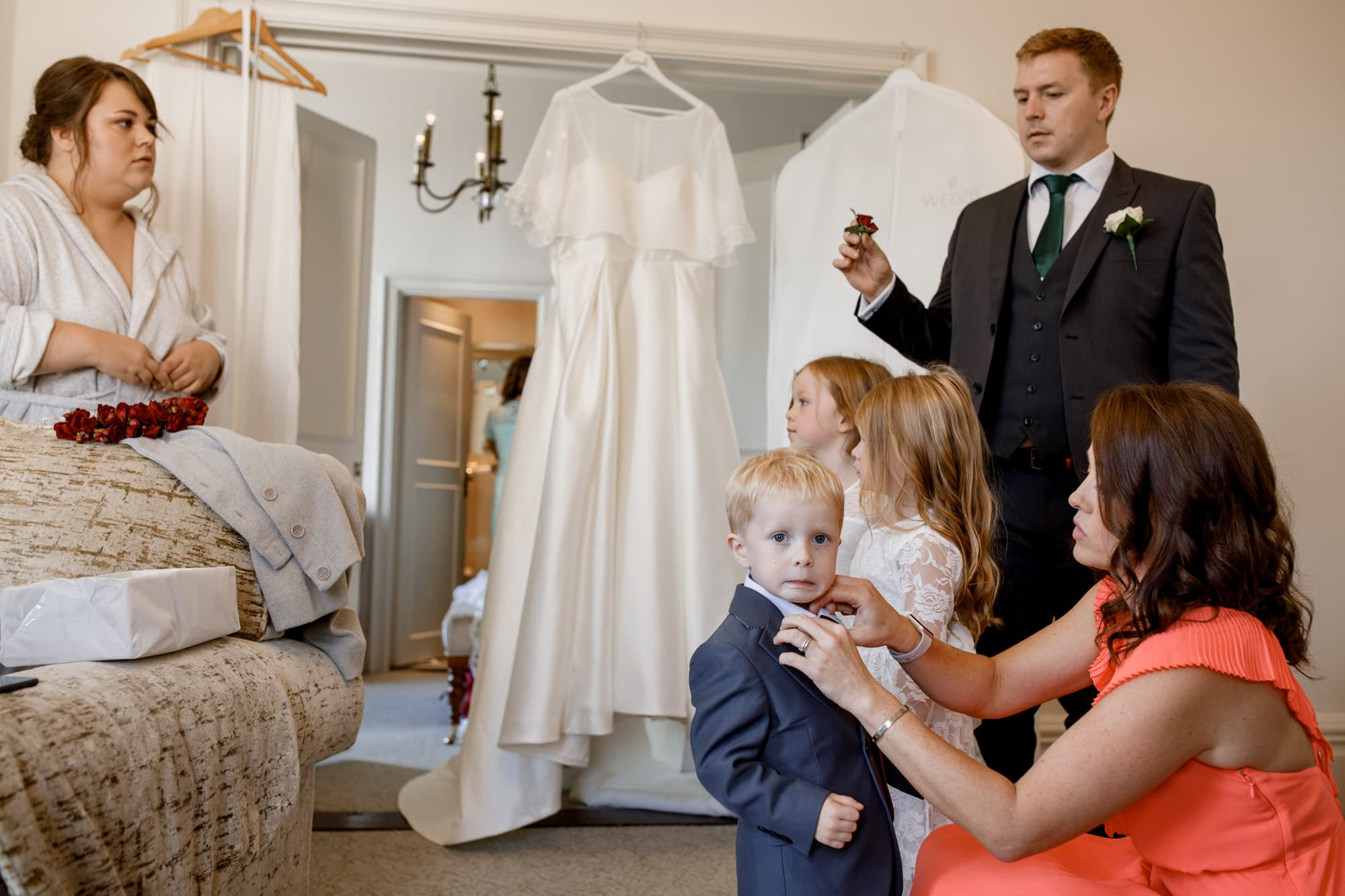 page boy pulling a face at oxford wedding