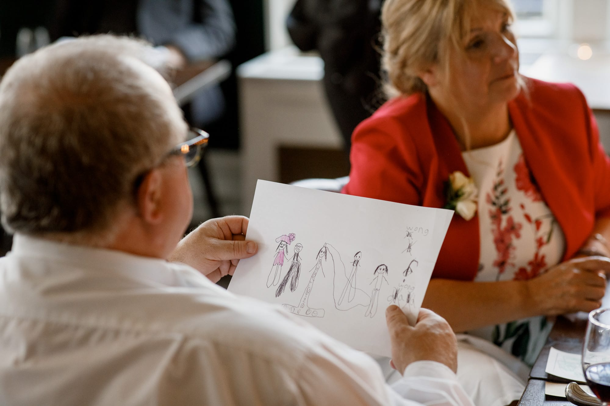 wedding guest looking at childs picture